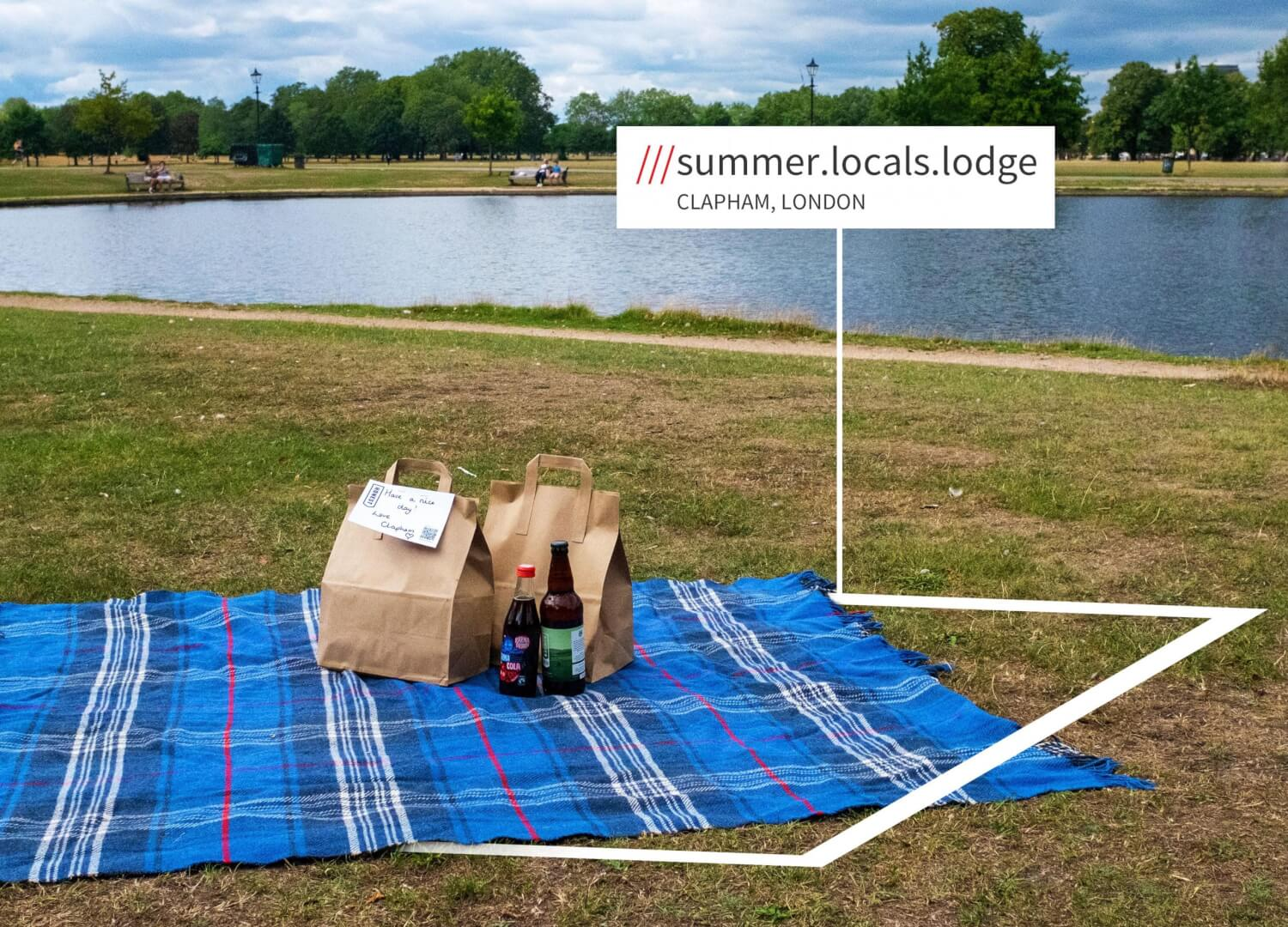A picnic blanket on Clapham Common, with a burger delivery