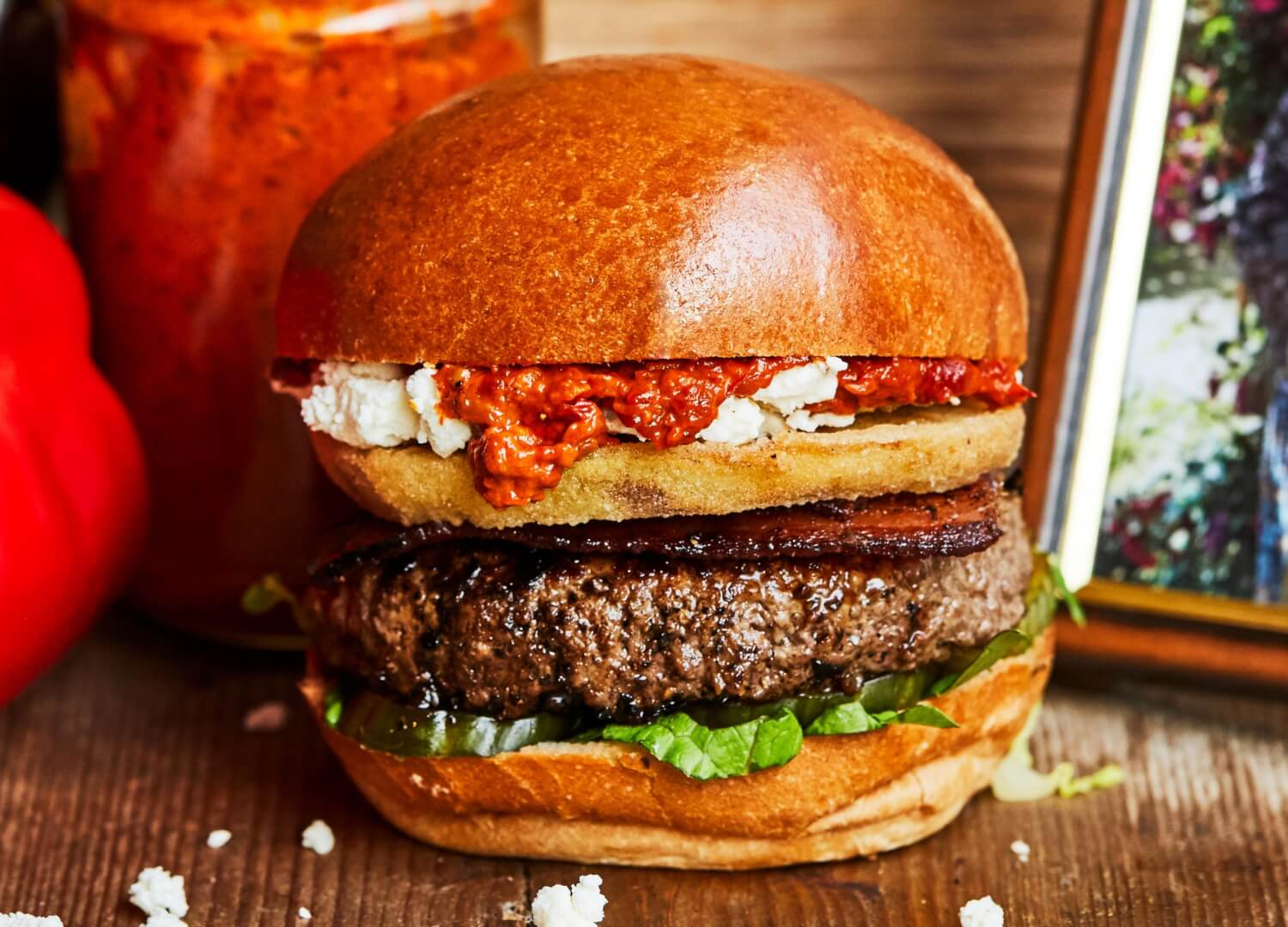 Beef burger with bacon, feta, red pepper and aubergine