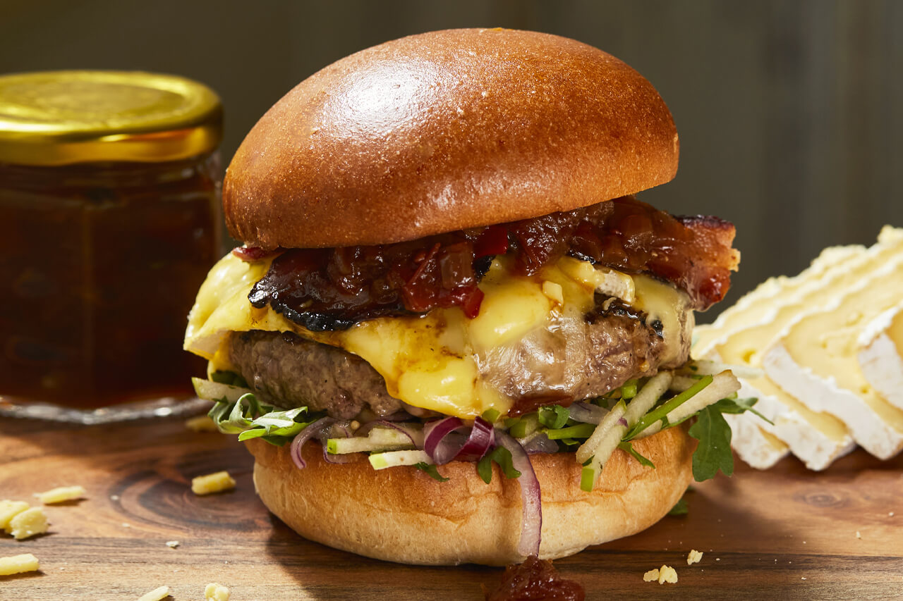 Reading Market Place- A beef burger with, bacon, Waterloo & Heckfield cheese, apple slaw, tomato, & chilli chutney, rocket, pickles, rosemary chips